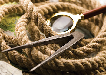 magnifying glass, rope, and compass