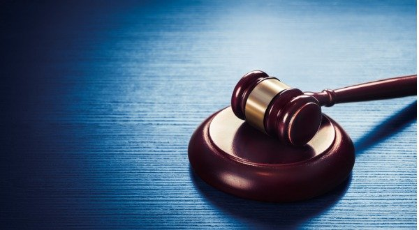 judge gavel on a blue wooden background