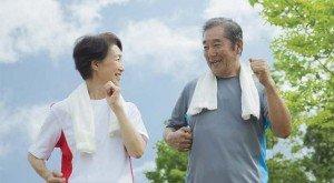 geriatric couple exercising