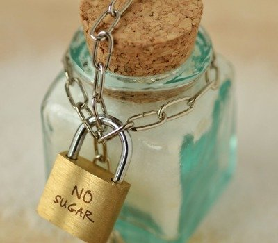 sugar jar wrapped in chain with padlock